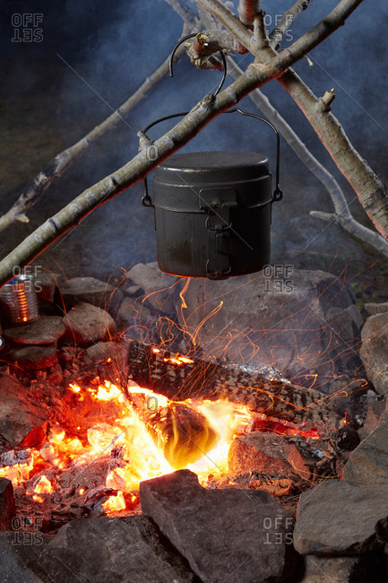 Pot of food cooking over camp fire, close-up, Colgate Lake Wild Forest, Catskill Park, New York State, USA