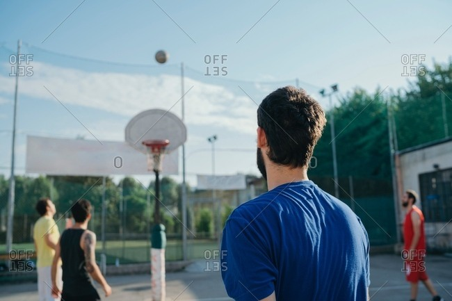 Friends on basketball court playing basketball game