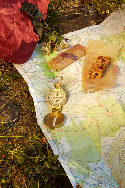 Map, compass and energy bar on grass, close-up, Colgate Lake Wild Forest, Catskill Park, New York State, USA