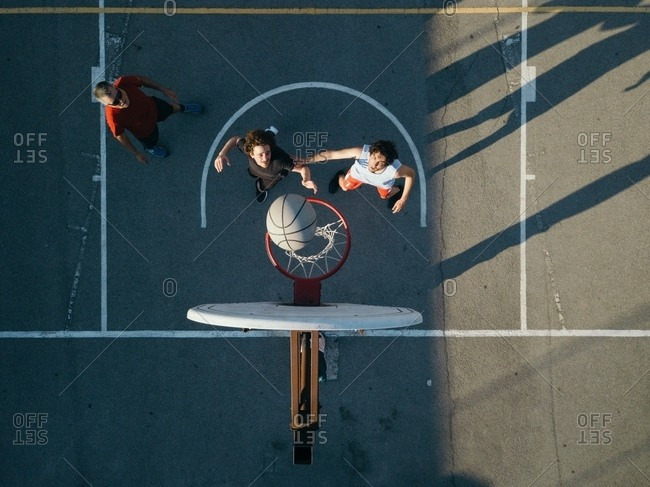 Overhead view of friends on basketball court playing basketball game