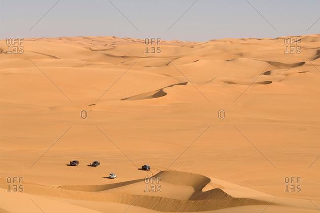 SUV on sand dunes, Erg Awbari, Sahara desert, Fezzan, Libya