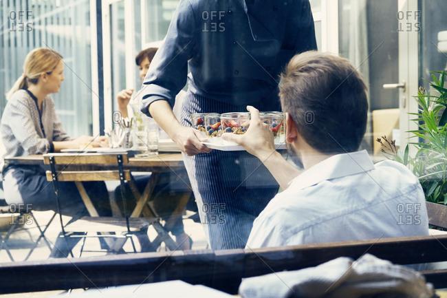Business colleagues having break on terrace