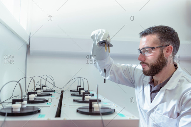Scientist age testing electrical cable in electrical cable laboratory