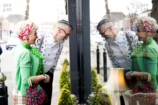 Quirky vintage couple window shopping at vintage shop