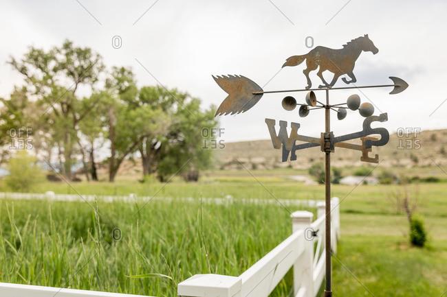 Horse and arrow weather vane on ranch, Bridger, Montana, USA