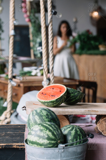 Halved watermelon on cutting board