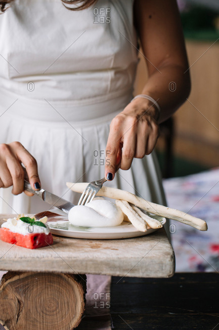 Woman preparing vegetarian dish on cutting board