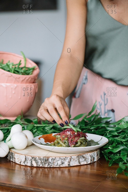 Woman preparing vegetarian dish