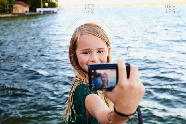 Girl taking selfie by river