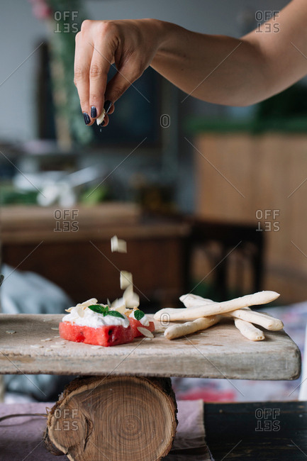 Woman preparing vegetarian dish on cutting board