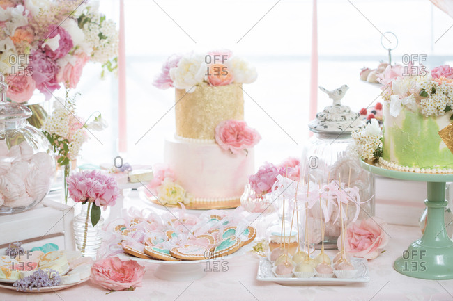 Dessert table with a variety of cookies and cakes