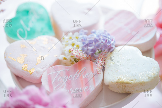Heart shaped cookies on a plate with flowers