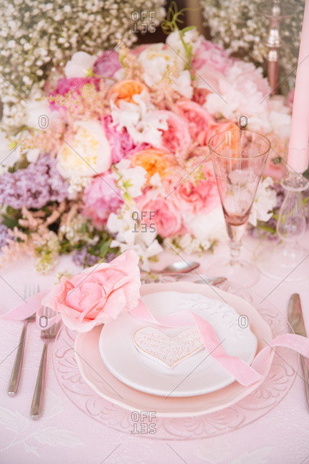 Place setting at a bridal shower with peony centerpiece