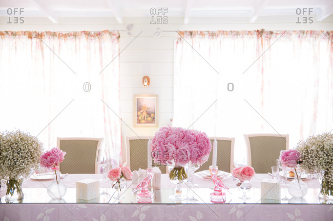 Table at a bridal shower with pink peony centerpiece