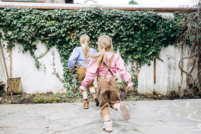 Two girls wearing lederhosen