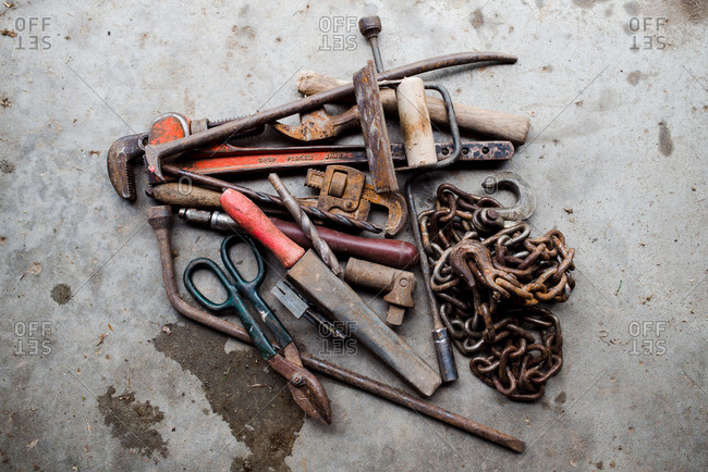 Variety of old rusty tools in a pile
