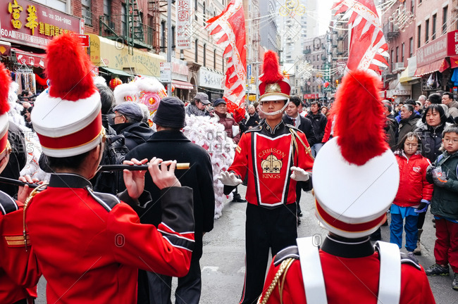 New York City, New York, USA - March 1, 2014: Marching band playing on street parade in Chinatown, New York City