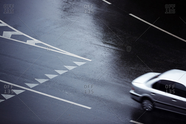 City road with marking under the rain