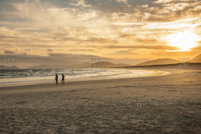 Brazil, Santa Catarina, Ilha Santa Catarina  - December 11, 2012: Sunset at Joaquina beach