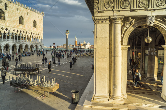 Italy, Veneto, Venice  - April 23, 2015: Piazzetta San Marco, with view of Biblioteca Marciana Palace, Palazzo Ducale and San Giorgio Maggiore church in the middle of the lagoon