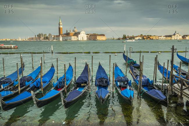 San Marco, Riva degli Schiavoni, Gondola on the canal and Isola di san Giorgio Maggiore in behind