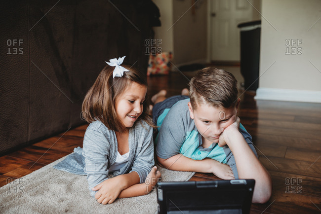 Kids watch a tablet together