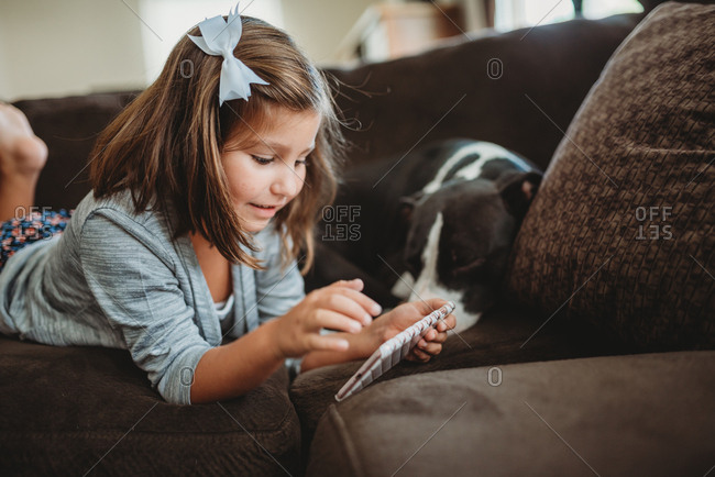 Little girl using a mobile phone at home