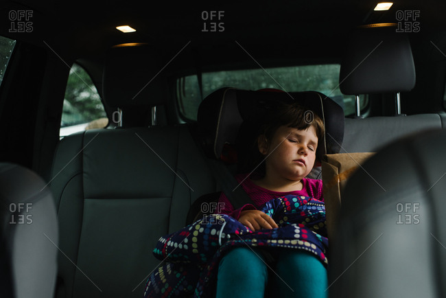 Girl asleep in her seat in car