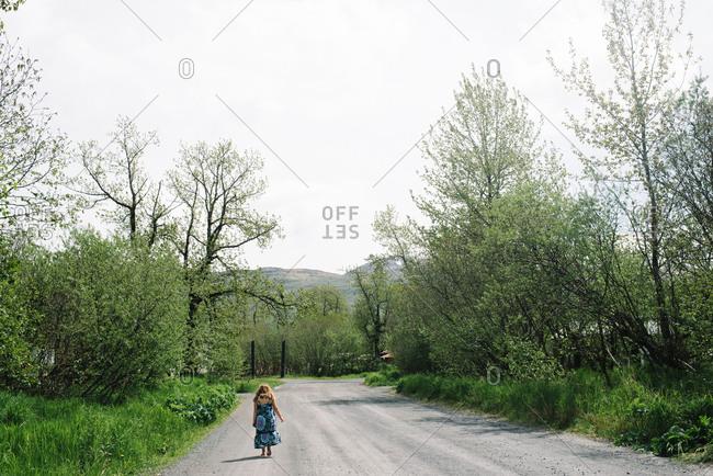 Girl walking down driveway in dress