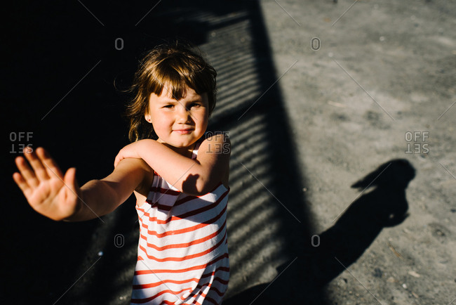 Girl with hand in air