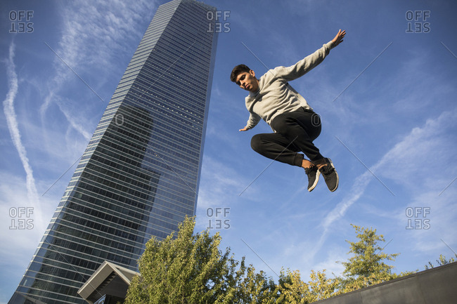 Man jumping during a parkour training