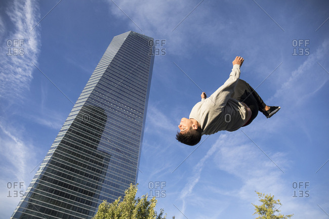 Man doing flip during parkour training