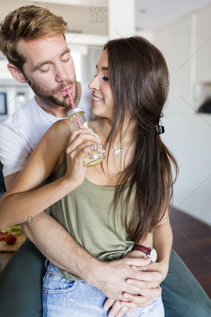 Couple enjoying drink sitting together