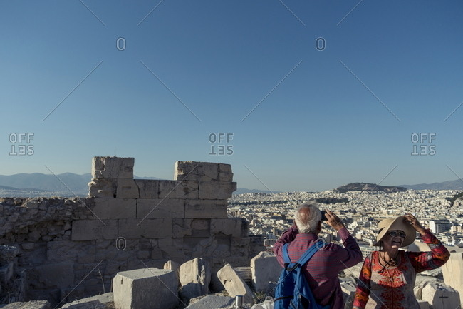 Athens, Greece - July 21, 2017: Couple visiting the Acropolis