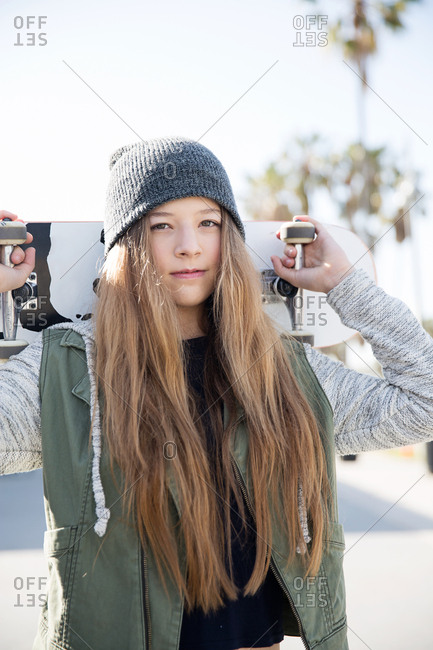 Los Angeles, California - April 26, 2016: April 26, 2016: Teen girl poses with skateboard