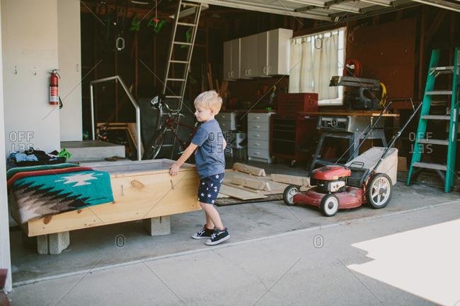 Boy busy in garage