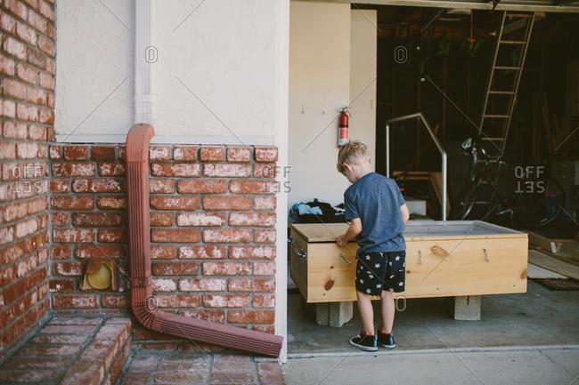 Boy playing in garage