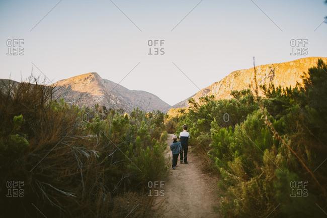 Boys walking on trail