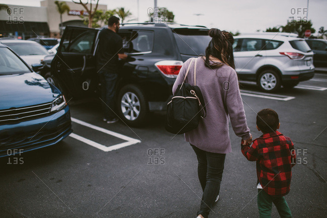 Mother and son walking in parking lot