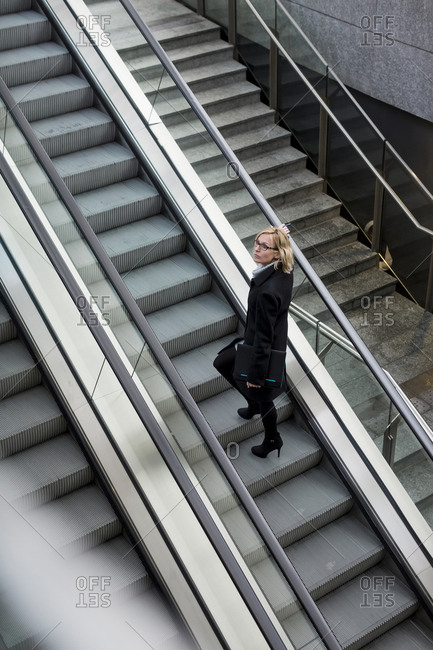 Businesswoman on escalator