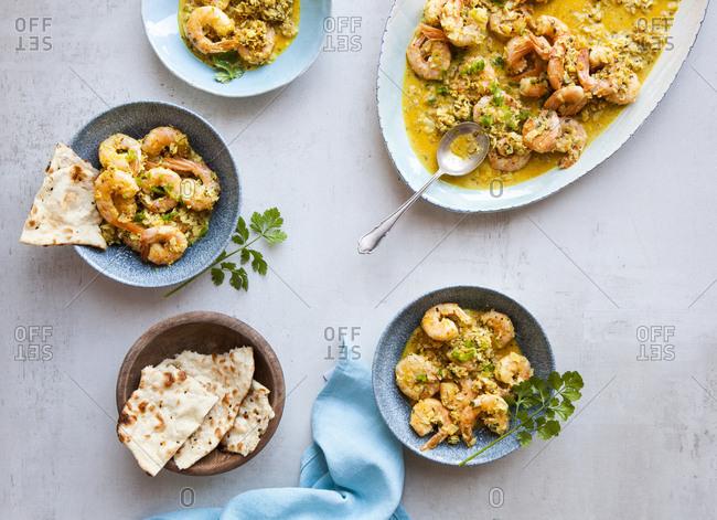 Sri Lankan prawn shrimp curry platter served with paratha