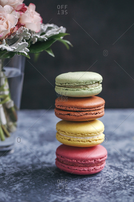 Stack of colorful macaroons on grey background