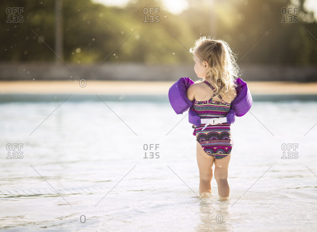 Girl in pool with floaties