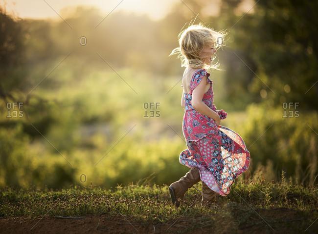 Girl in prairie standing in dress