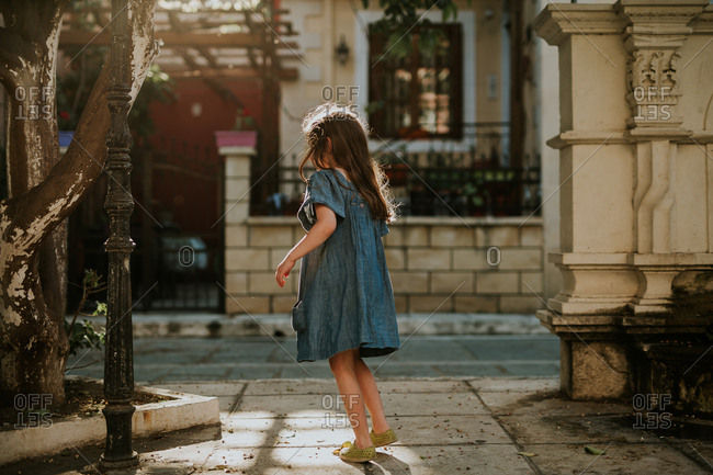 Girl walks on a sunny street