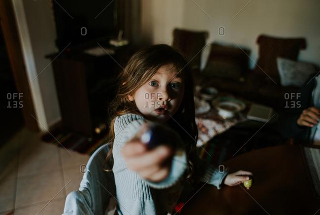 Girl offering an Easter egg