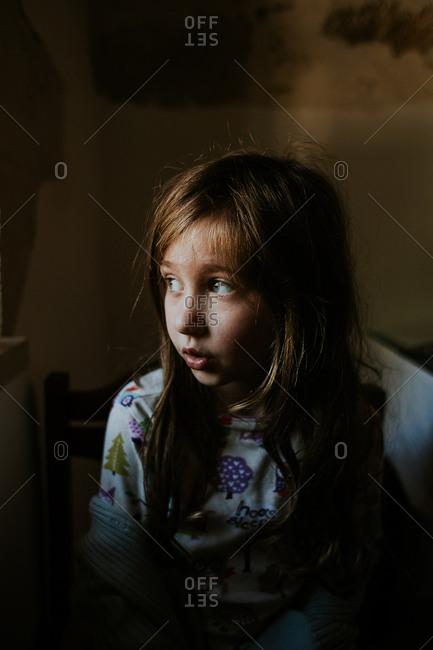 Girl sitting near a window