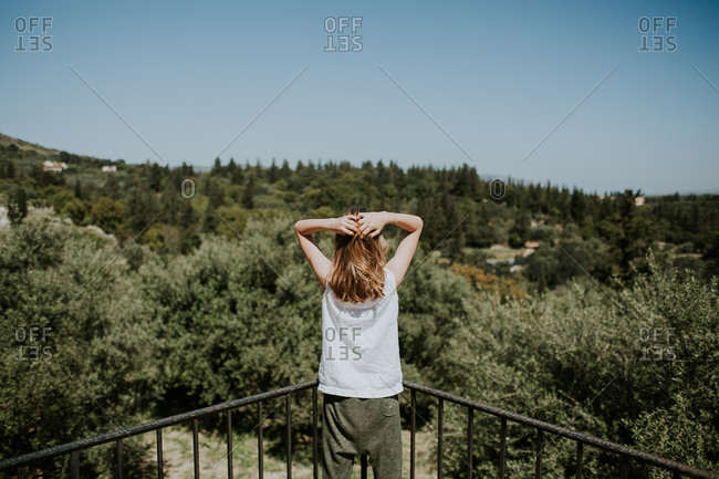 Girl stretching on a balcony