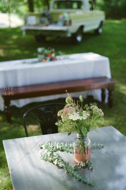 Tables in rural yard set for celebration