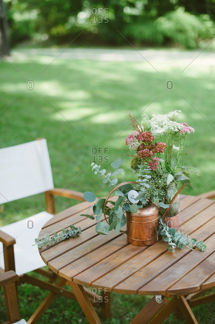 Flower decorations on outdoor table